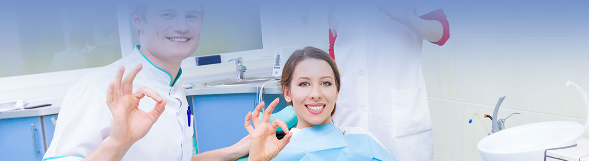 Cropped image of dentist, patient and assisting showing hand gesture